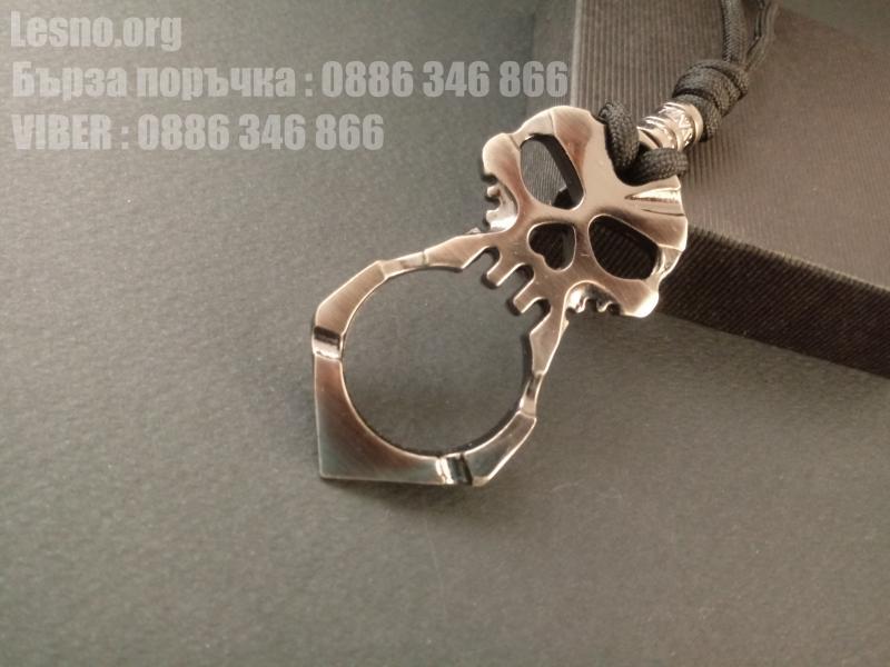 Малък бокс тип ключодържател череп за носене на показалеца