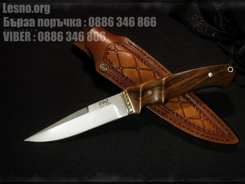 Ловен нож с бронзов гард и дръжката следва извивката на ръката